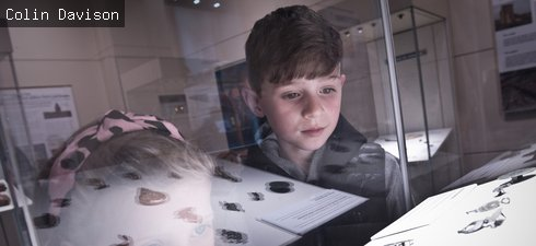 Two children look in a gallery case