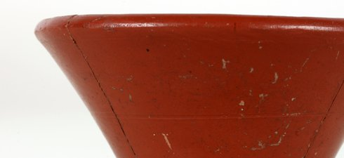 This is a samian drinking cup, imported from Franc