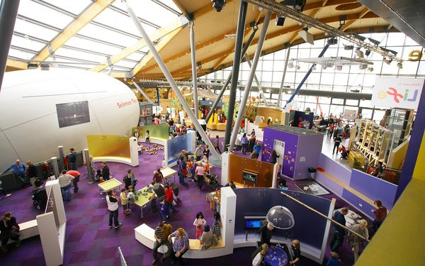 The interior of the Life Science Centre showing visitors and the science theatre attraction