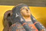 Ancient Egyptian decorated coffin with golden female face and headdress
