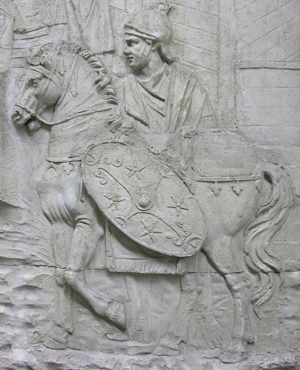 Stone sculpture of Roman soldier on horseback with shield