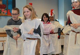 Children enjoying roman party