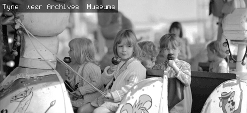 Children eating toffee apples at the Hoppings on Newcastle Town Moor, June 1973 (TWAM ref. DT.TUR/2/61856L).