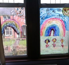 Window paintings of rainbows and flowers at a home during the coronavirus pandemic 2020