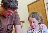 Dad and daughter engage in craft activity