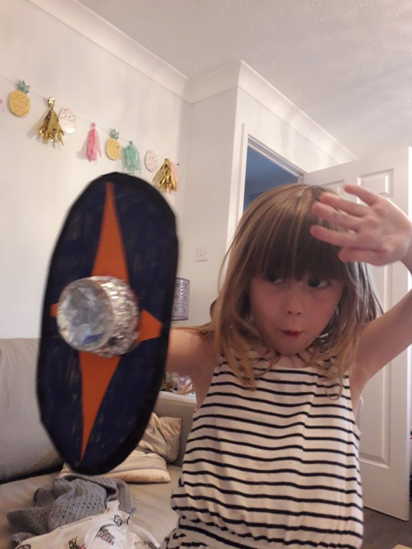 Child holding up shield