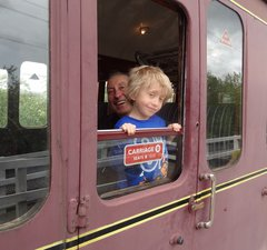 Man and boy at train carriage window