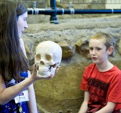 A member of the learning team at Arbeia Roman Fort with some young visitors