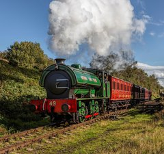 Green locomotive pulling carriages
