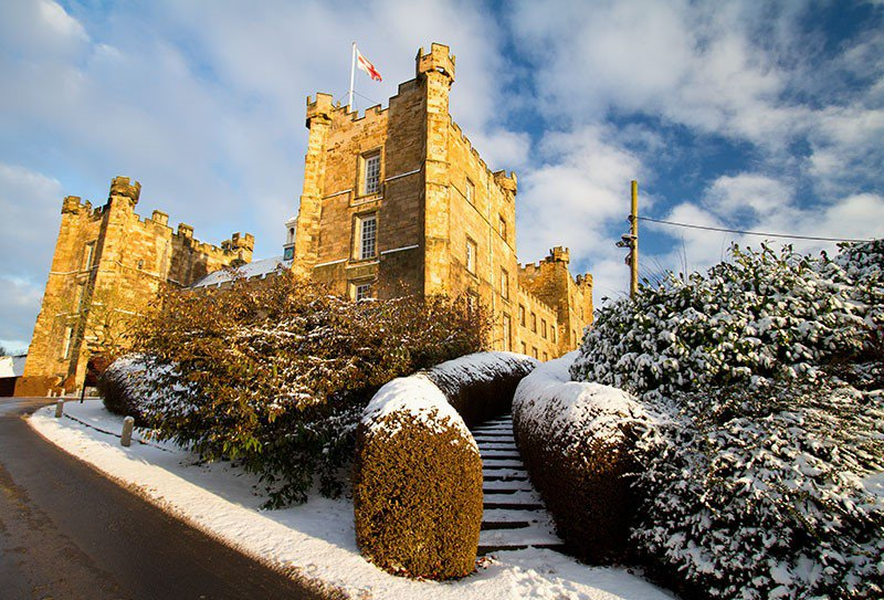 Exterior of Lumley Castle Hotel in the snow