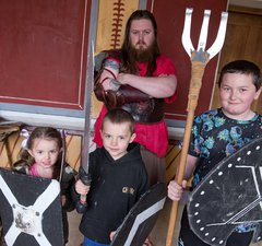 children with replica weapon and gladiator