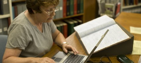 Lady using research services on laptop