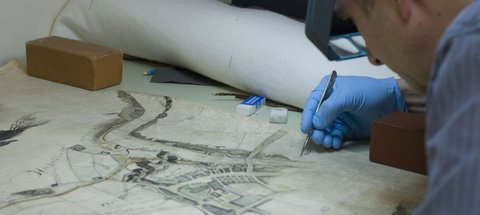 Conservation work on an old map