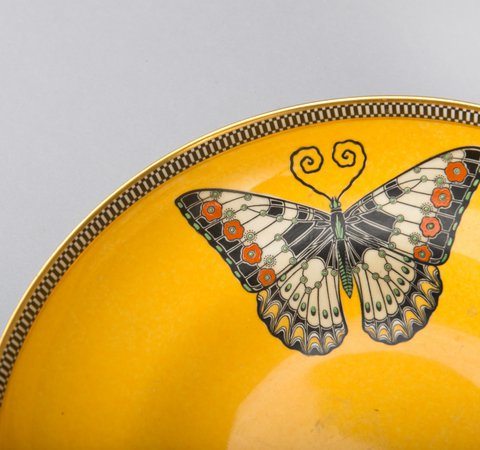 Yellow ceramic bowl with butterfly detail