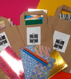 A photograph of some craft materials and Hatton branded paper bags