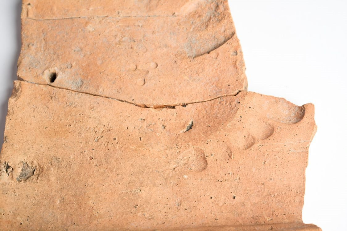Human footprint on a Roman clay roof tile