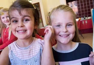 two girls aged 8 smiling