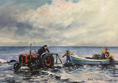 Two fisherman and a man in a tractor towing a fishing boat out of the sea