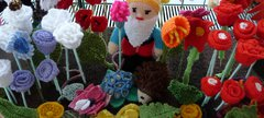A knitted gnome and flowers
