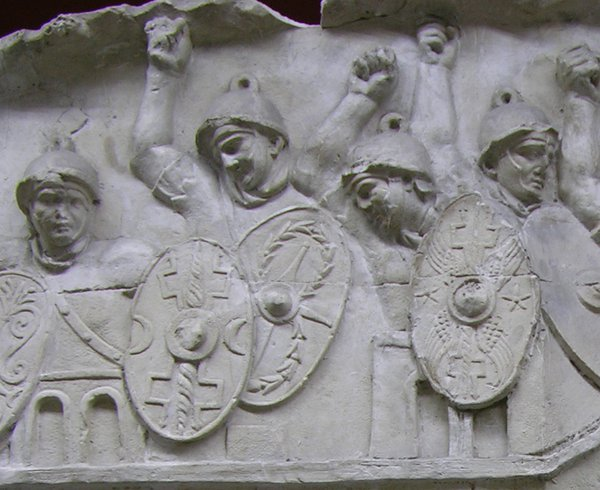 Stone sculpture of Roman soldiers with shields