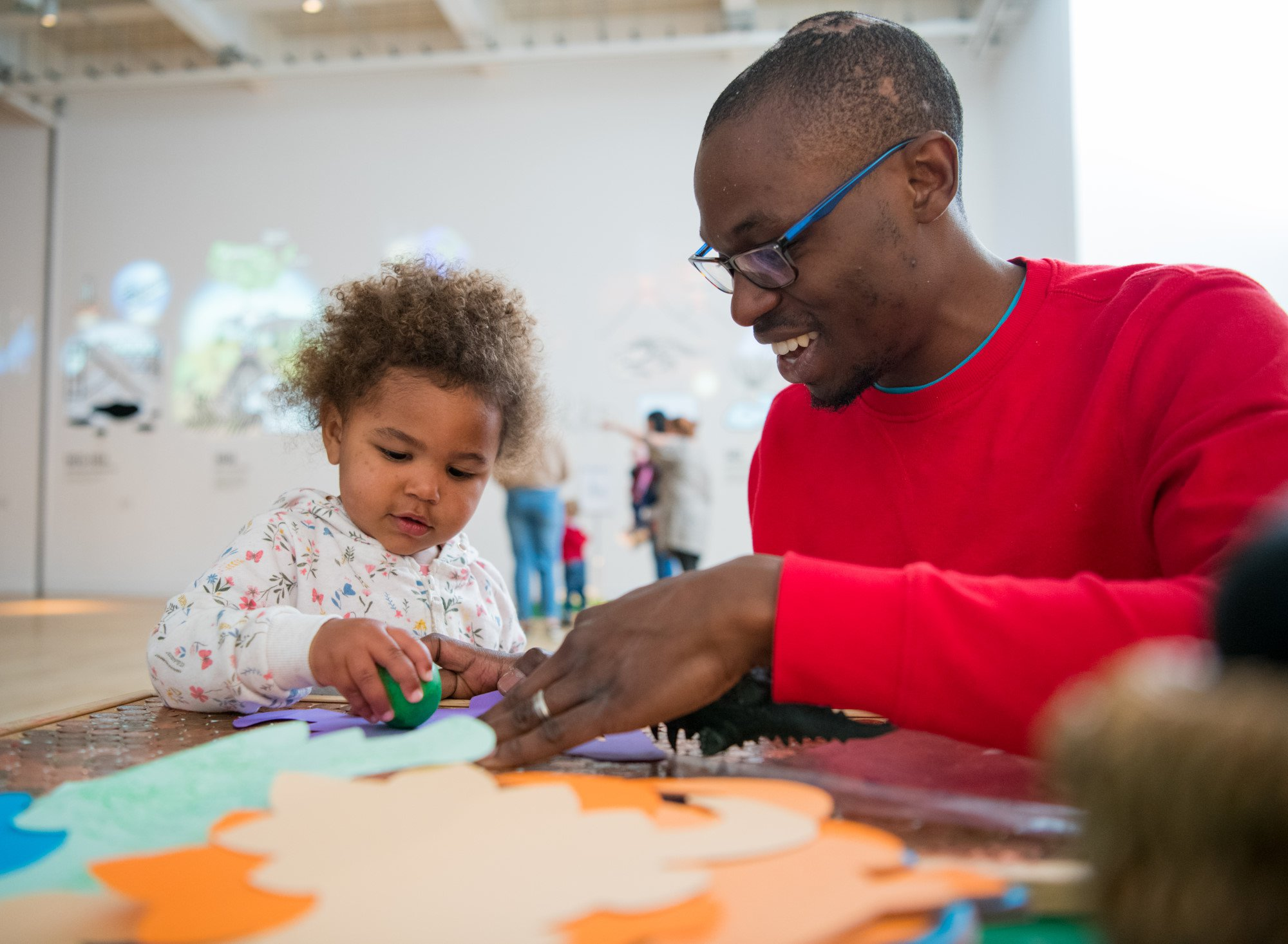 A father and toddler enjoy a craft activity at the Great North Museum