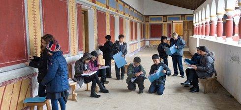 schoolchildren work in the Roman reconstruction