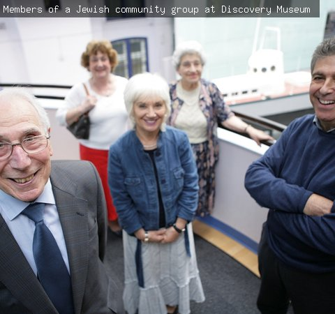 Members of a Jewish community group at Discovery Museum