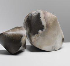 Two earthy-coloured cyclinder/triangular ceramic pieces by artist Mella Shaw