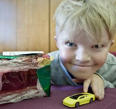 Blonde boy with his toy car