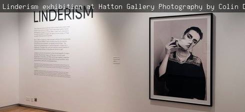 Photo of Linderism exhibition featuring a black and white photomontage and the exhibition intriduction
