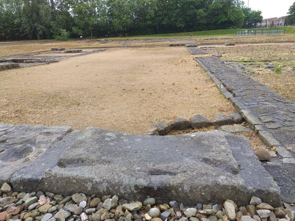 Headquarters building threshold stone