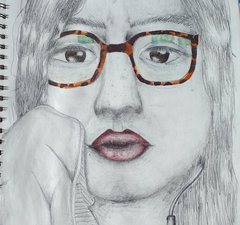 A pencil drawing of a young girls face