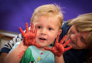 A child enjoys funded arts activity in Bellingham, Northumberland