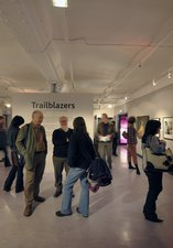 A number of people in the temporary gallery looking at the Trailblazers exhibition