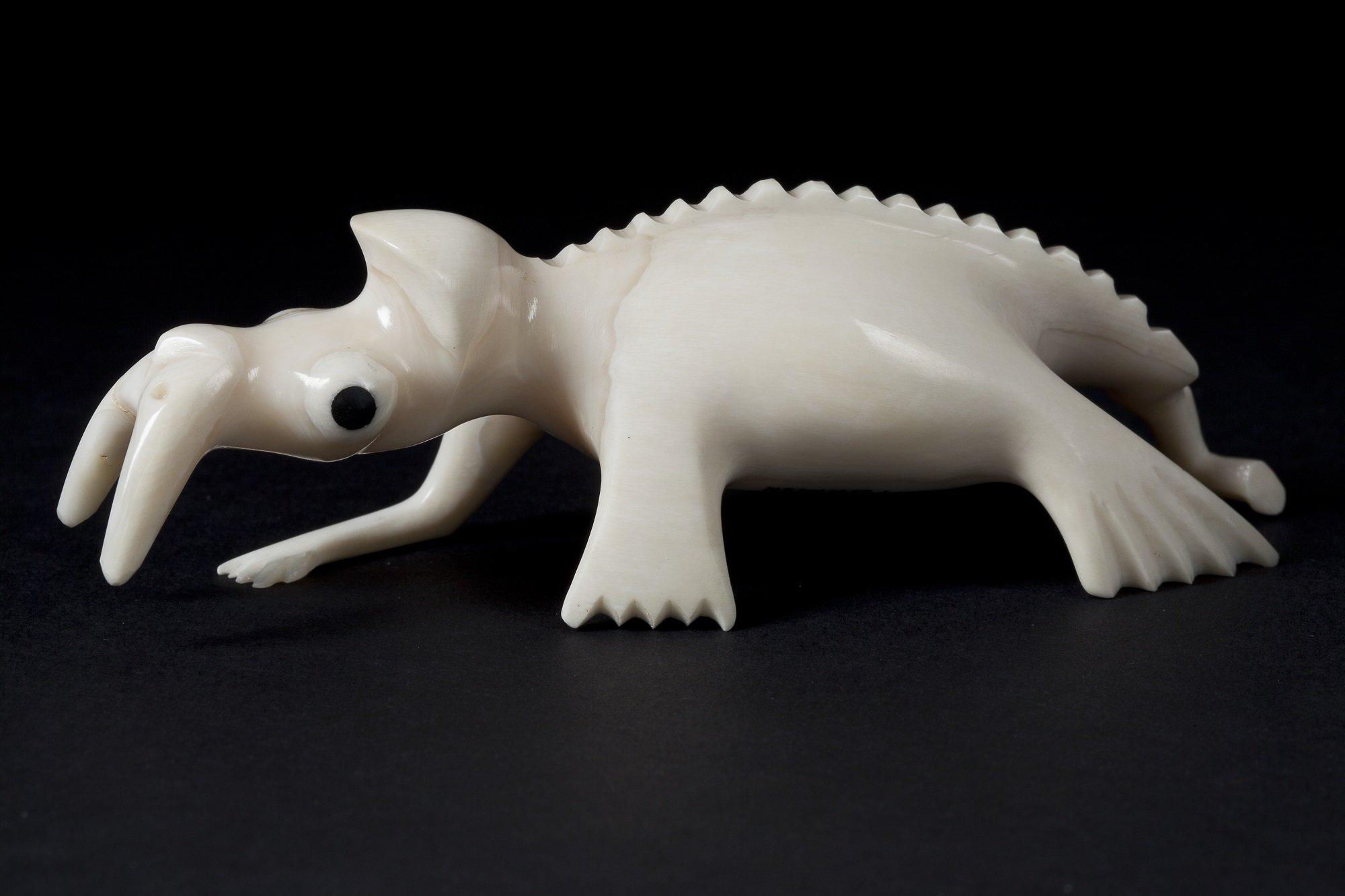 An ivory Tupilak resembling a walrus