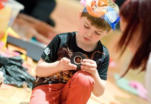 A child helping create Neverland at Big Wednesday
