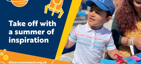 small boy does crafts outside Discovery Museum in the sun; on the left is a dark blue graphic with whit text saying: Take off with a summer of inspiration