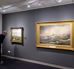Man looks at a picture in the gallery