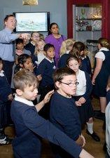 Adam Bell showing school children the gallery