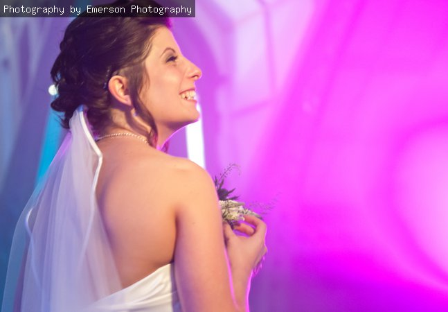 Bride Laura smiling with pink background