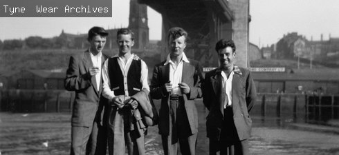 Four men at stand on the River  Tyne quayside