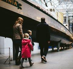 A family walks past the Turbinia exhibit