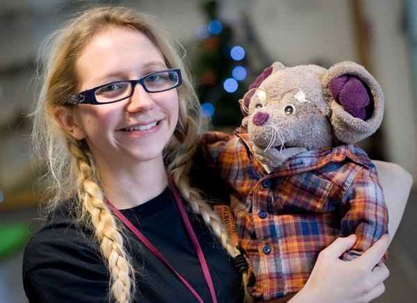 A staff member from the Great North Museum holds Albany Mouse, the mascot of the Mouse House under 5s' gallery