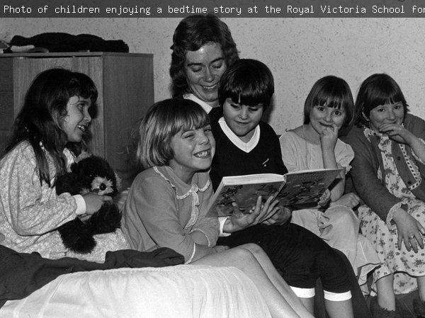 Photo of children enjoying a bedtime story at the Royal Victoria School for the Blind, Newcastle upon Tyne, 1982