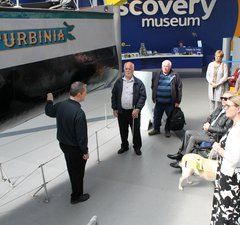 A group visiting Discovery Museum