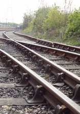 Railway tracks stretching towards the platform